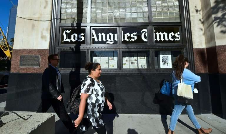 Patrick Soon-Shiong finalized a deal to take over the Los Angeles Times Monday and named as executive editor veteran journalist