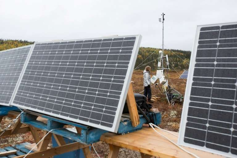 Researcher Michelle Garneau's team is building a temporary weather station to record data from the area near the Romaine hydroel