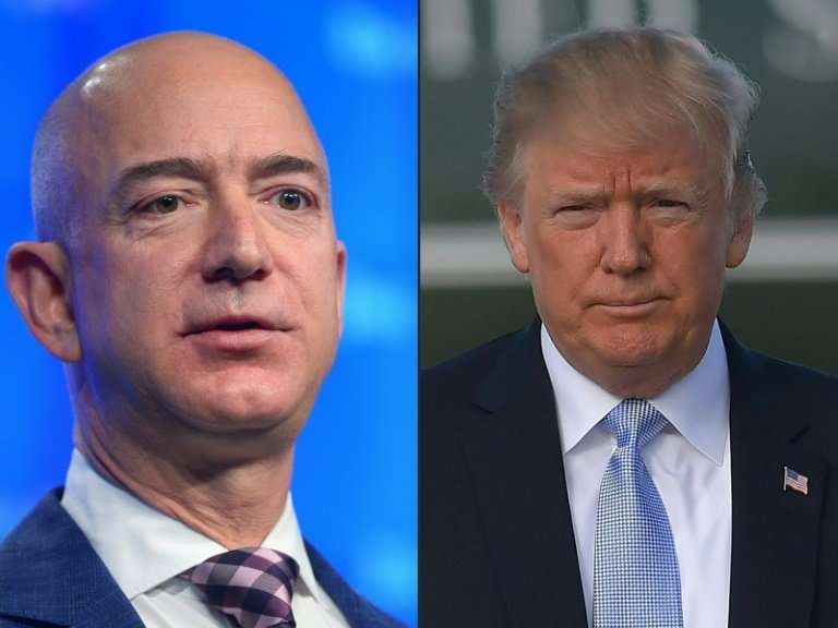 This combination of pictures  shows Amazon founder Jeff Bezos (L), who also owns The Washington Post, and US President Donald Tr