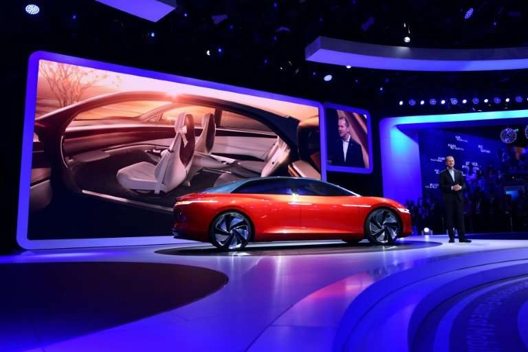 """Volkswagen CEO Herbert Diess showed off the """"I.D. Vizzion""""  concept car, which is also conceived as being electric and"""