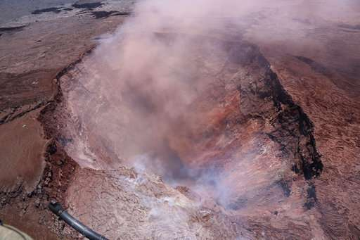 Hawaii volcano sends lava bubbling, forces 1,500 from homes