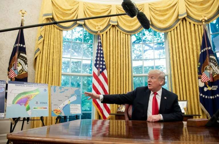 US President Donald Trump speaks during a briefing on Hurricane Michael in the Oval Office of the White House