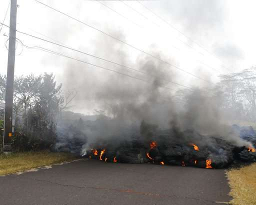 Hawaii officials airlift 4 residents after lava crosses road