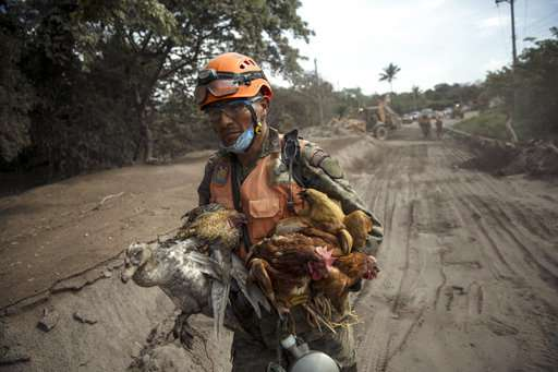 At Guatemala volcano, weather and danger halt search