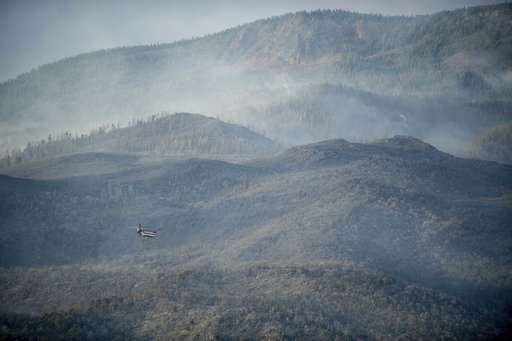 Fires menace US West, tornado touches Colorado wildfire site