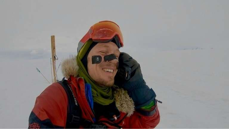 American adventurer Colin O'Brady calls his wife after becoming the first person to cross Antarctica without assistance of any k