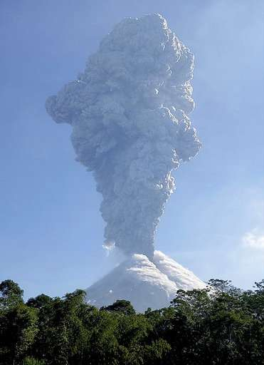 Indonesia's Merapi volcano ejects towering column of ash