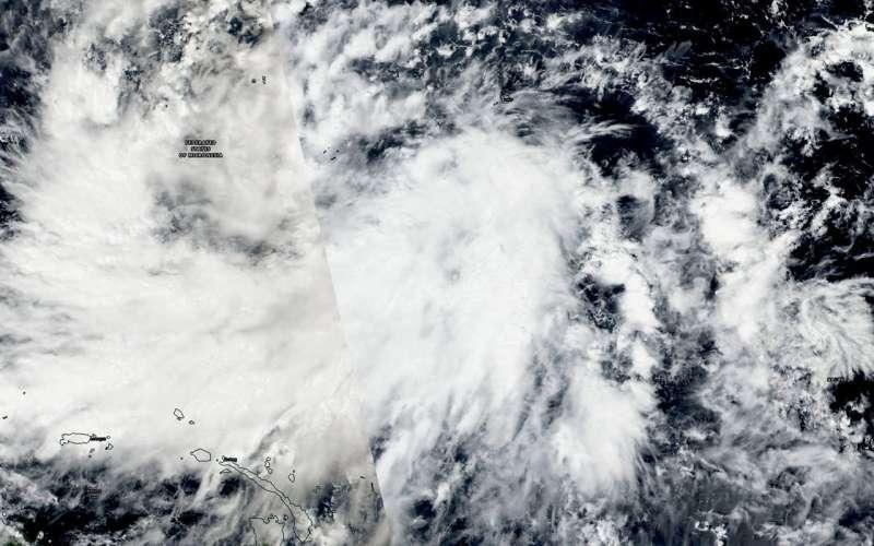 NASA sees Tropical Depression Man-yi, warnings triggered