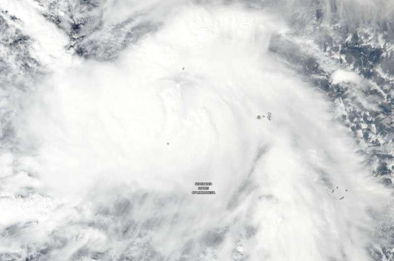 NASA sees Tropical Storm Man-yi approaching typhoon strength Tropical Storm Man-Yi con