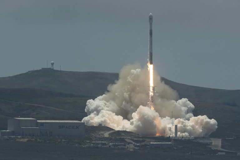 The SpaceX Falcon 9 rocket carrying the GRACE twin satellites and five Iridium commercial communication satellites as seen in th