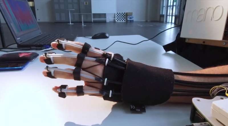 Feedback enhances brainwave control of a novel hand-exoskeleton