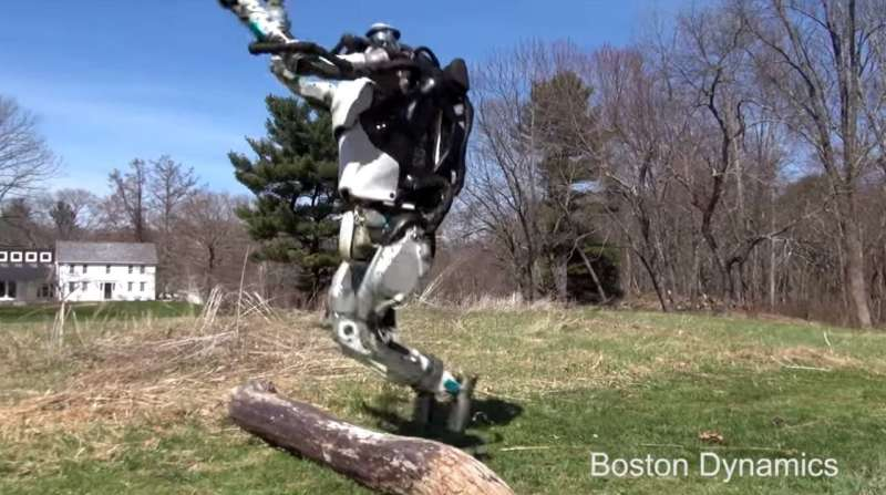 Humanoid Atlas gets some air and jogs, jumps over log