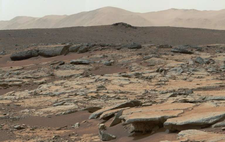 A 2013 mosaic of images from NASA's Curiosity Mars rover shows a series of sedimentary deposits on the planet, which the US hope