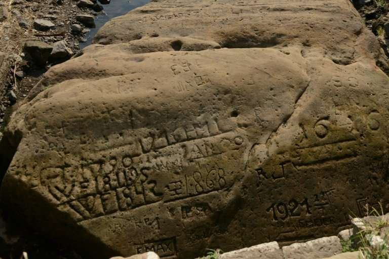 """About 20 such """"hunger stones"""", engraved with markers and dates going back centuries, can still be found on the banks o"""