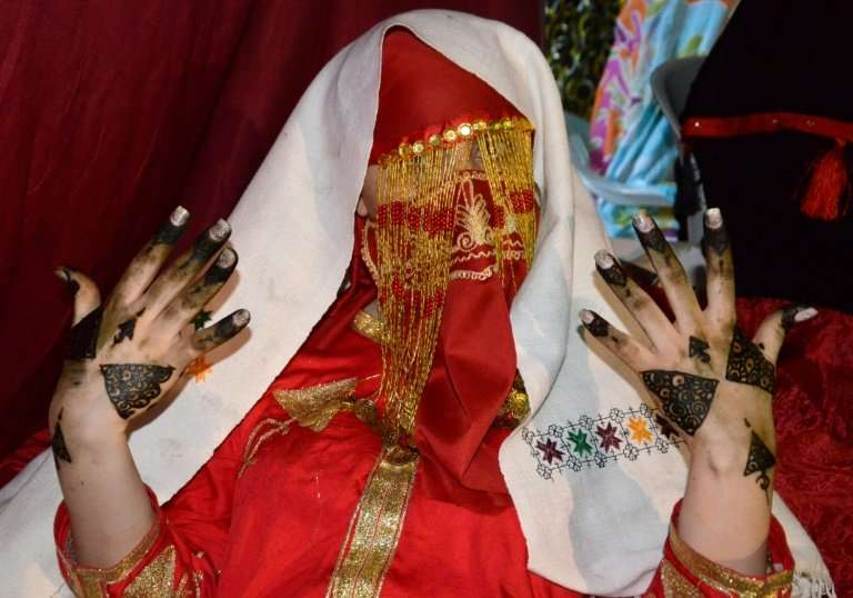 A bride shows her henna-painted hands, the day before her wedding in Gabes, Tunisia