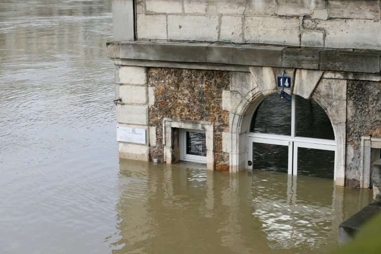 A cafe in Paris partly submerged in the rising waters of the River Seine
