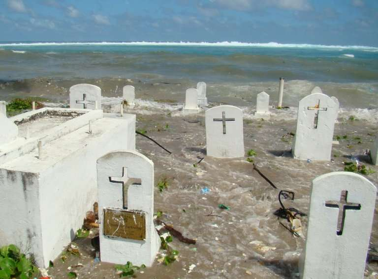 A cemetery in Majuro Atoll is flooded during high tide in the low-lying Marshall Islands, a Pacific atoll chain that sits barely