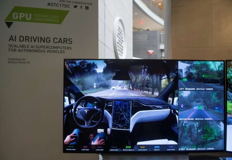 A display demonstrates the sensors and technology behind self-driving cars during a conference showcasing artificial intelligenc