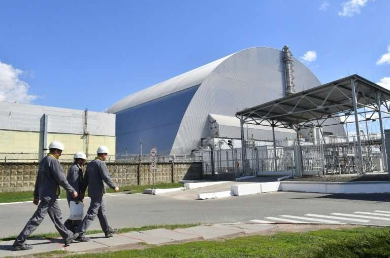 A fire broke out around the Chernobyl nuclear power station but radiation levels at the site of the world's worst nuclear disast