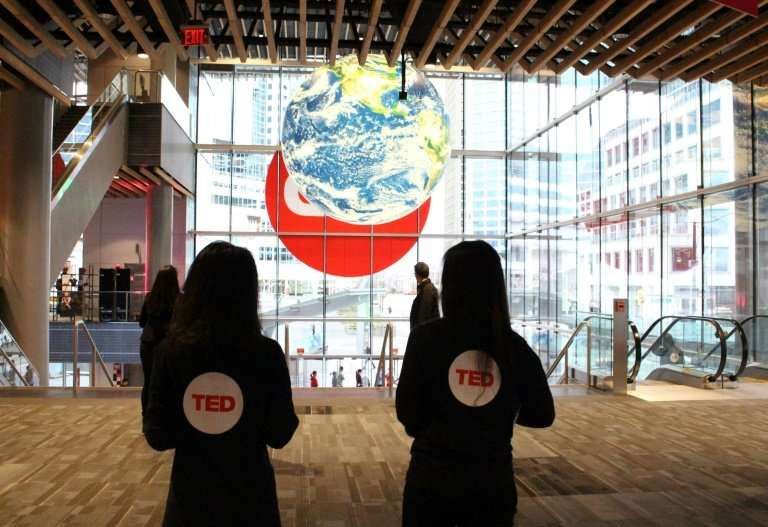 A globe of the world hangs above the entrance to the big-vision TED Conference in Vancouver as people arrive on April 11, 2018