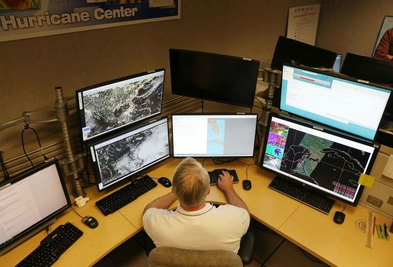 A hurricane specialist at the National Hurricane Center in Miami, Florida, tracks  storm systems on May 24, 2018