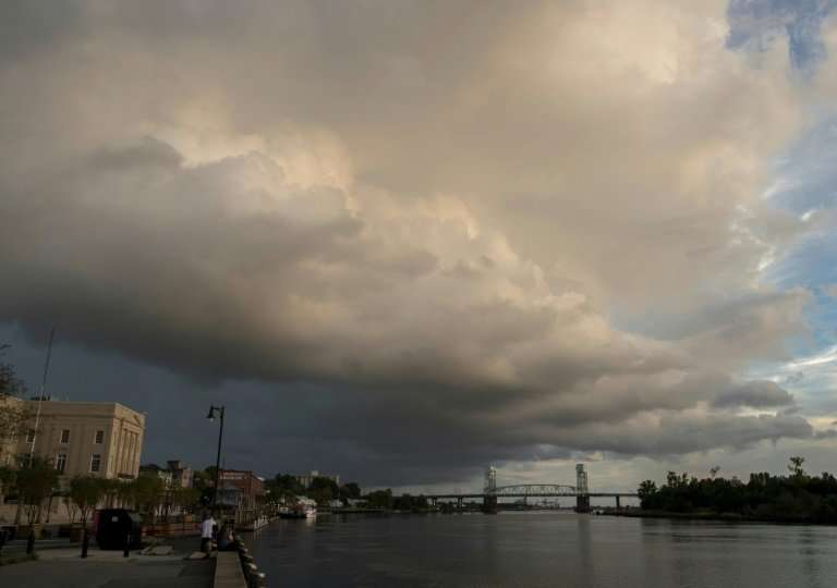 A large rain cloud passes over a day before the arrival of hurricane Florence in Wilmington, North Carolina, on September 12, 20