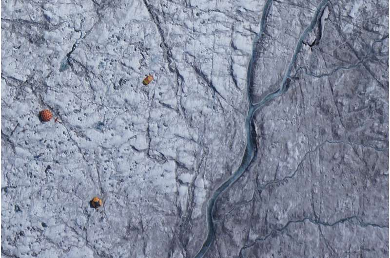 Algae, impurities darken the Greenland ice sheet and increase melting