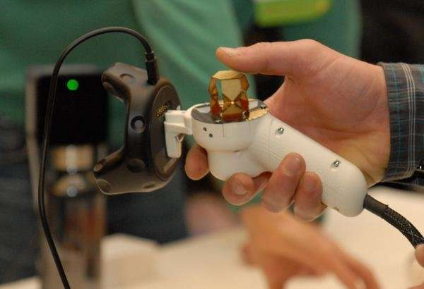 A little fold-up joystick brings haptics to portable devices