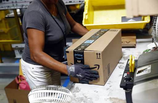 Amazon jumps out ahead of its rivals and raises wages to $15