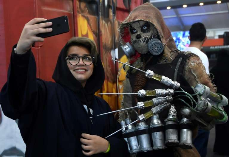 """A Saudi woman takes a """"selfie"""" at the first Comic-Con Arabia event in the capital Riyadh on November 25, 2017"""