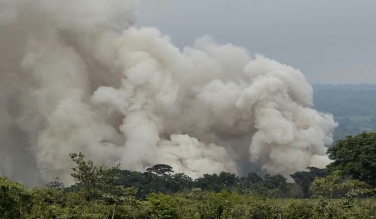 A smoke column billows from the lower part of the Fuego volcano near Guatemala City on June 5, 2018