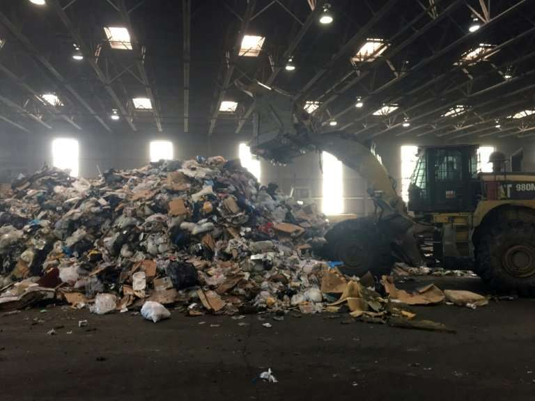 At the Fort Totten Transfer Station in Washington, trash is piled up before being taken by truck to a factory where it is incine