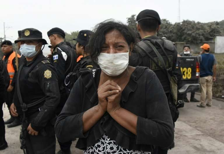 A woman cries for her missing relatives during the search for vicitms in San Miguel Los Lotes, a village in Escuintla Department