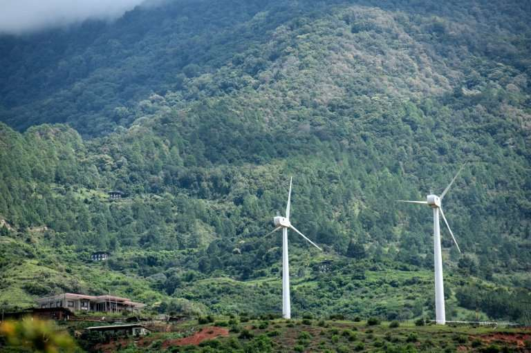 Bhutan's first pair of wind turbines in the village of Rubesa symbolise the Himalayan kingdom's achievement as the world's only