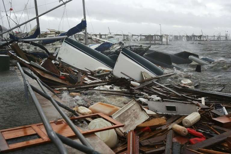 Boats in a pile of rubble after Hurricane Michael hit Panama City, Florida