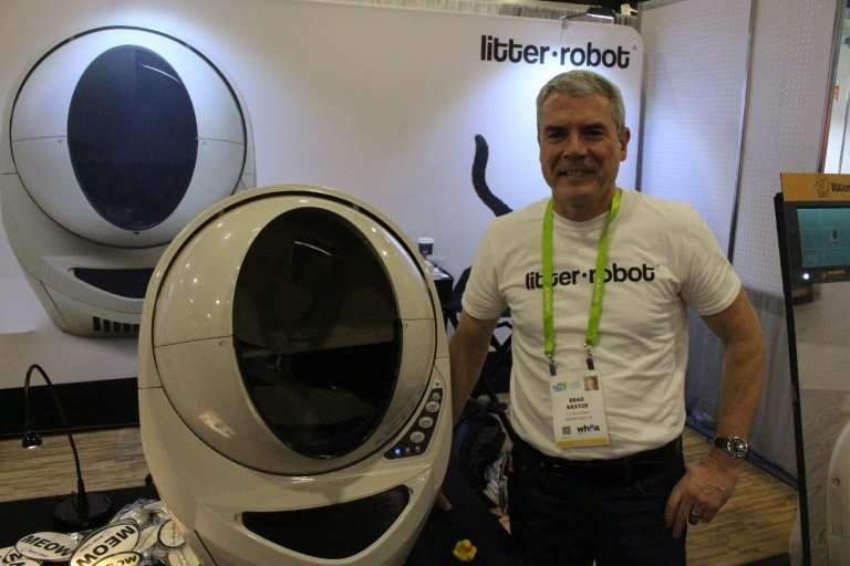 Brad Baxter of Litter-Robot demonstrates the automated, self-cleaning cat litter box at the 2018 Consumer Electronics Show
