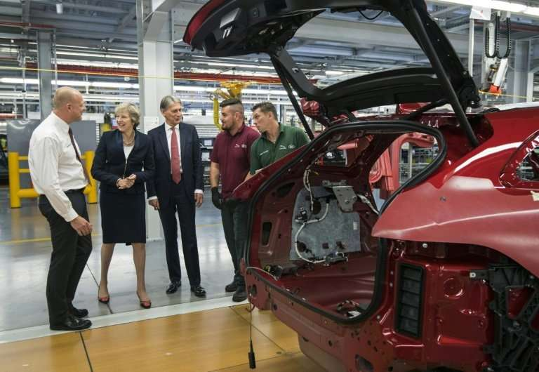 Britain's Society of Motor Manufacturers and Traders says it urgently needs clarity on the transitional arrangements for Brexit,