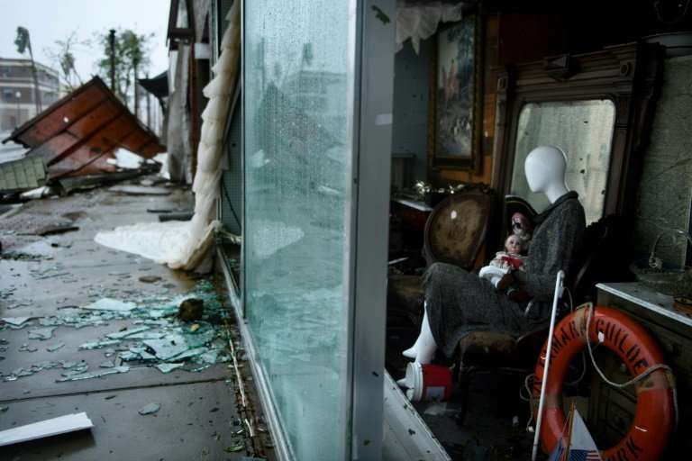 Broken glass and building debris litter the streets in Panama City, Florida, after Hurricane Michael crashed ashore