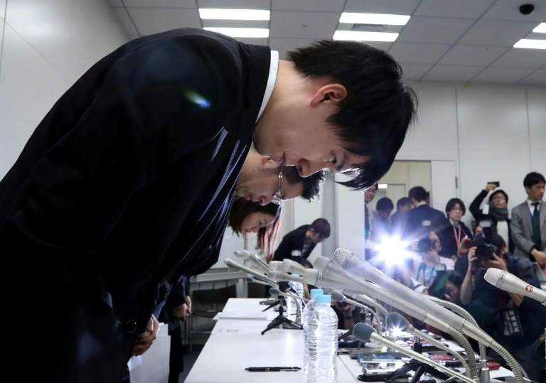 Coincheck president Koichiro Wada bows in apology at a news conference last weekend after hackers stole hundreds of millions of