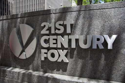 Comcast drops Fox bid, paving way for sale to Disney