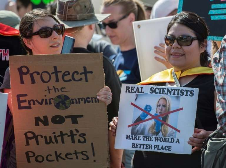 Demonstrators take part in the March for Science in Washington, DC on April 14, 2018; local scientists and supporters joined a g