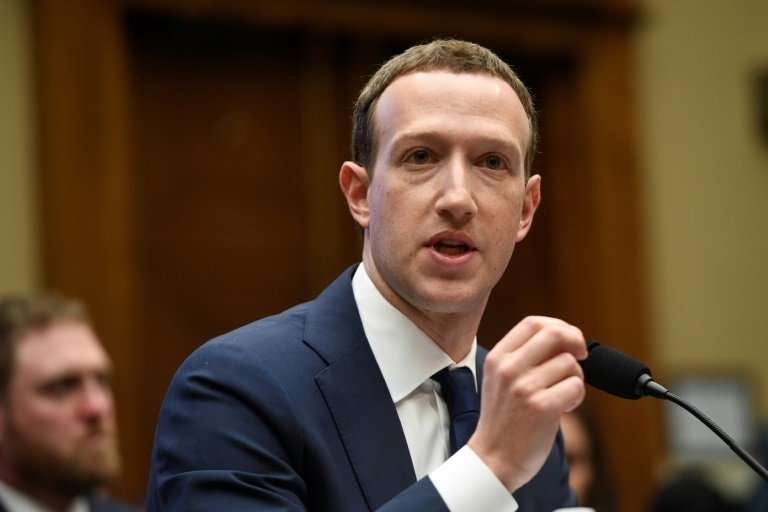 Facebook CEO and founder Mark Zuckerberg defends his company's business model to the US House Committee on Energy and Commerce