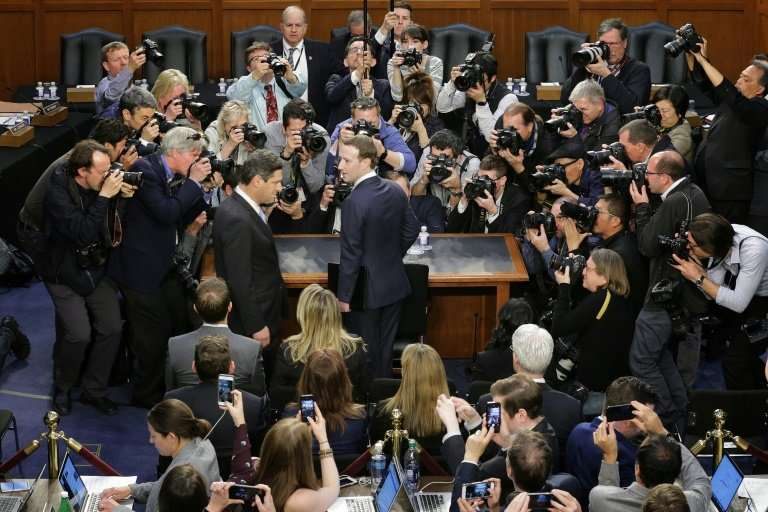 FFacebook CEO Mark Zuckerberg (C) faced tough questions about trustworthiness over the company's handling of users' personal dat