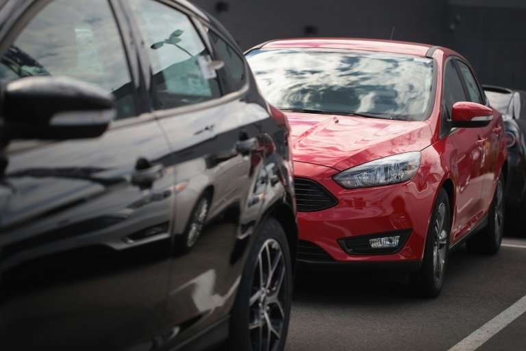 Ford Focus compact cars for sale at a Chicago dealership in June. Automakers said US market conditions remained healthy in the f