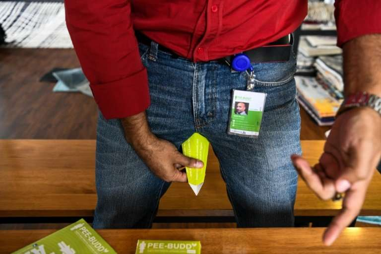 Founder of 'Pee Buddy' Deep Bajaj shows how to use a portable female urination device