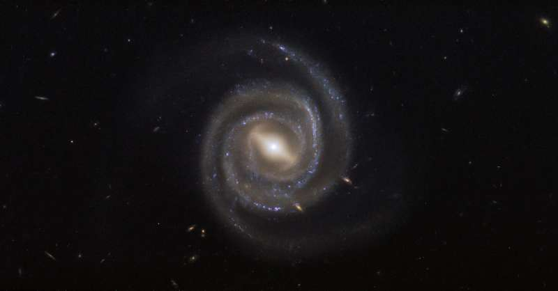 Hubble's barred and booming spiral galaxy