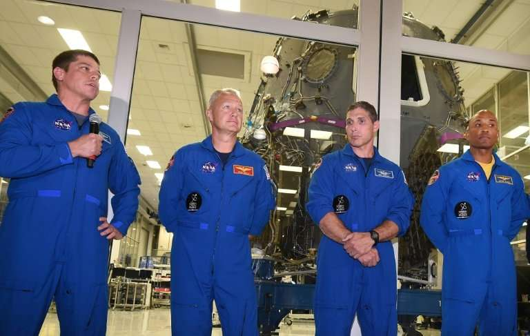 (L-R) Bob Behnken, Doug Hurley, Mike Hopkins and Victor Glover, the NASA astronauts chosen for the Commercial Crew Program to fl