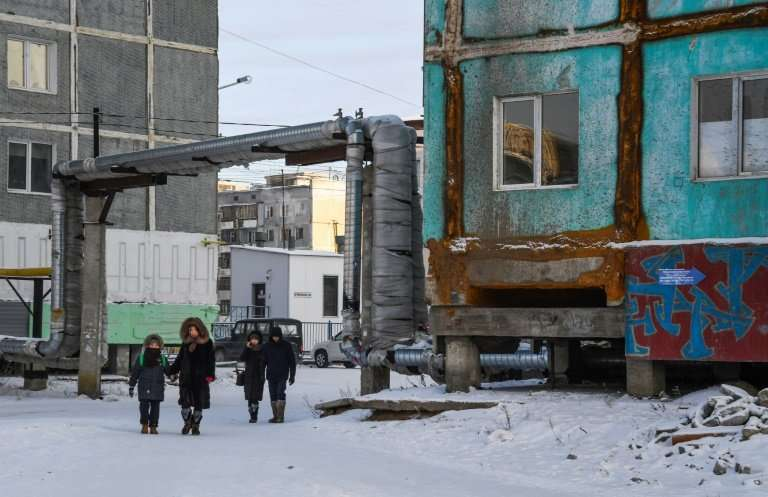 Many houses in Yakutsk are made up of concrete panels and stand on stilts which ensure ventilation of the building's underbelly