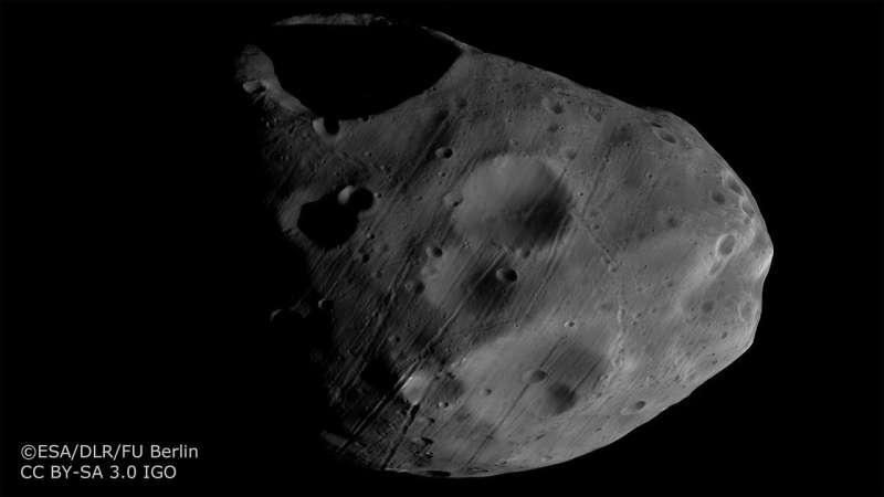 Mars Express views moons set against Saturn's rings