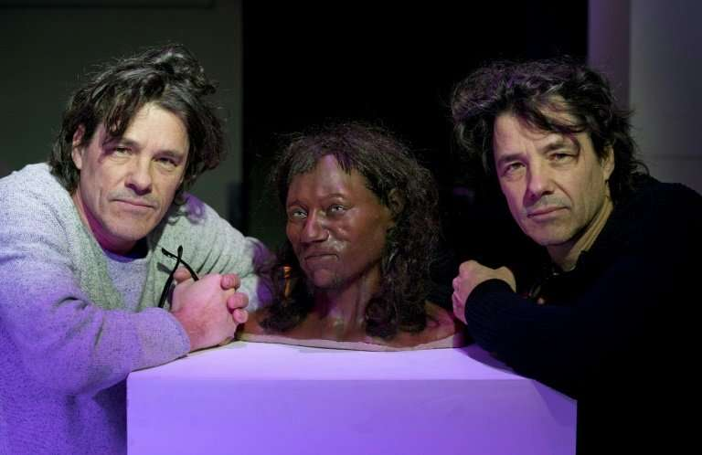 Model makers Adrie (L) and Alfons Kennis created the bust of 'Cheddar Man' using a high-tech scanner which had been designed for